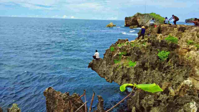fishing at the edge of the cliff