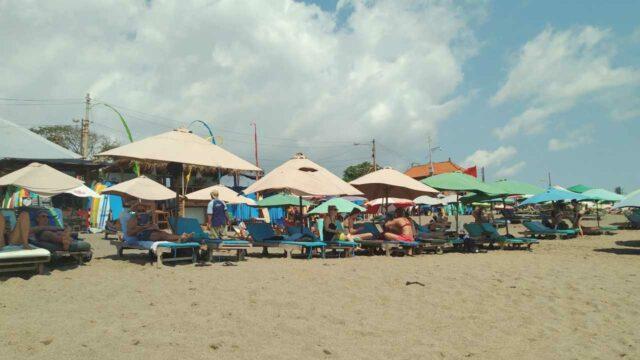 sunbathing canggu beach