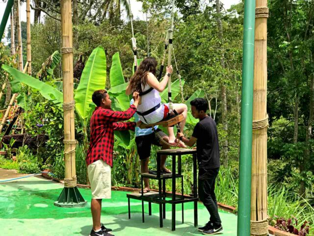 swing attraction tukad cepung waterfall